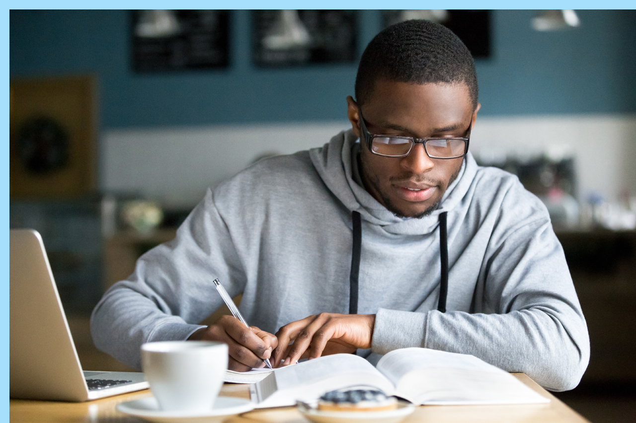 man studying in a coffee shop