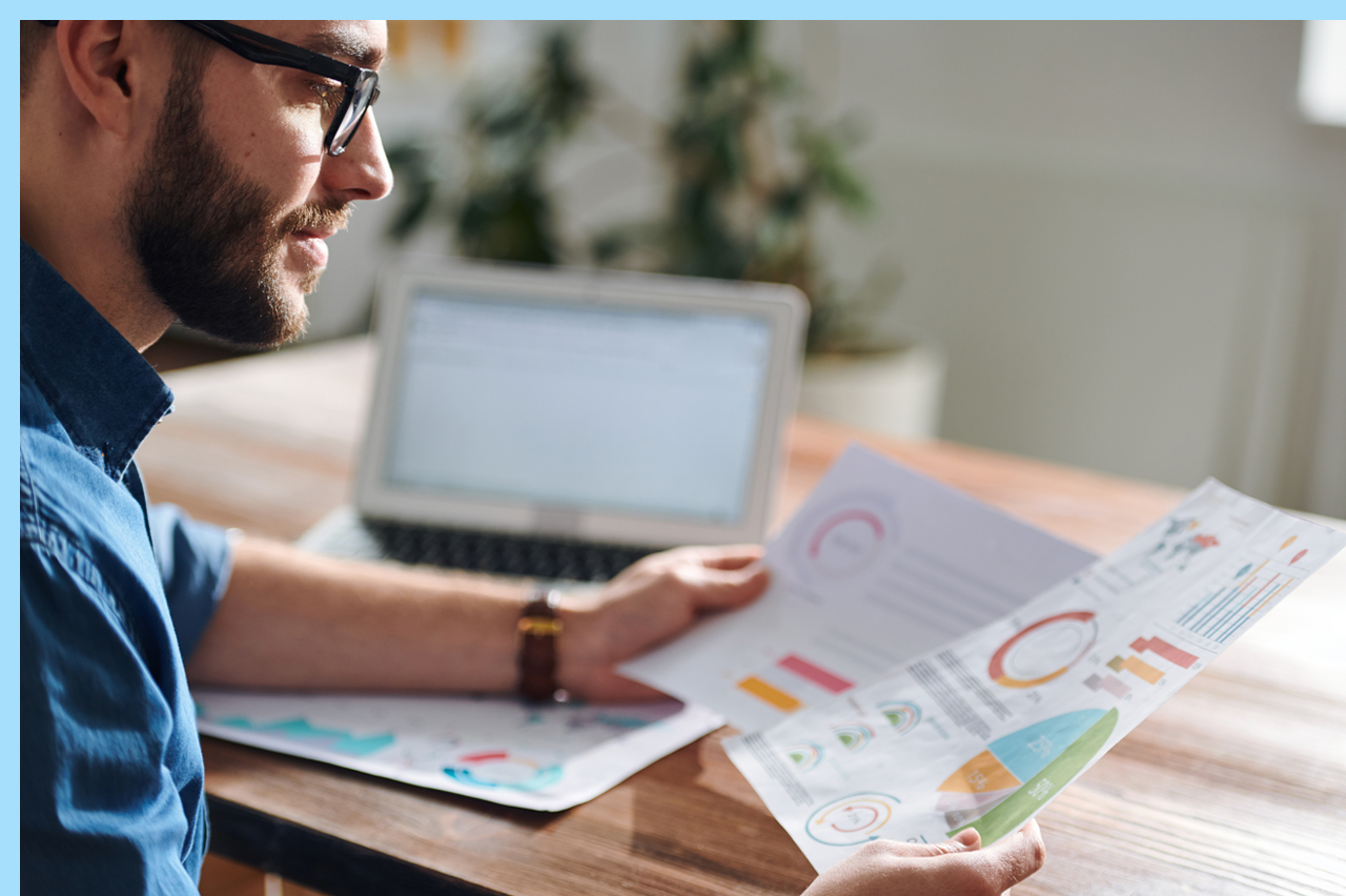 man looking over marketing plan