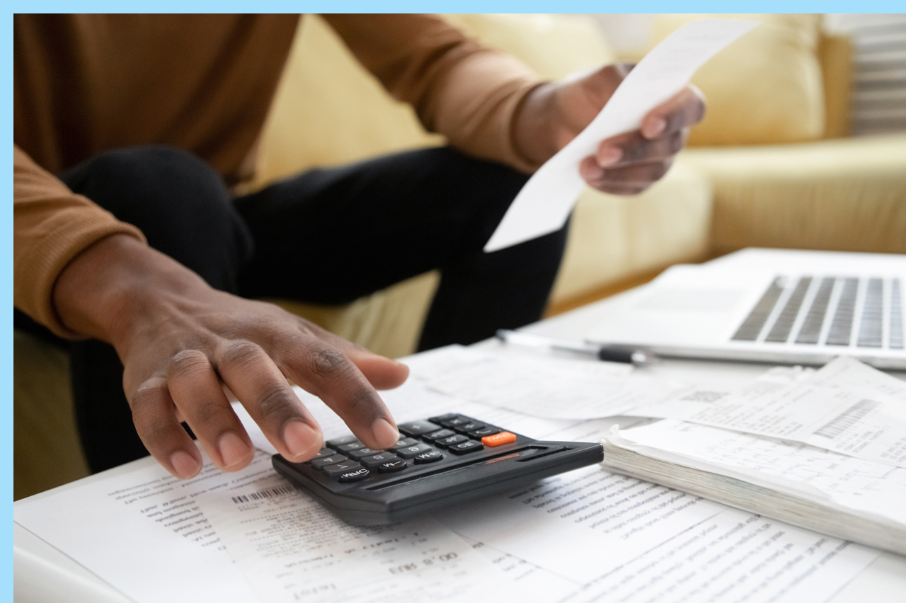 person calculating expenses with a calculator
