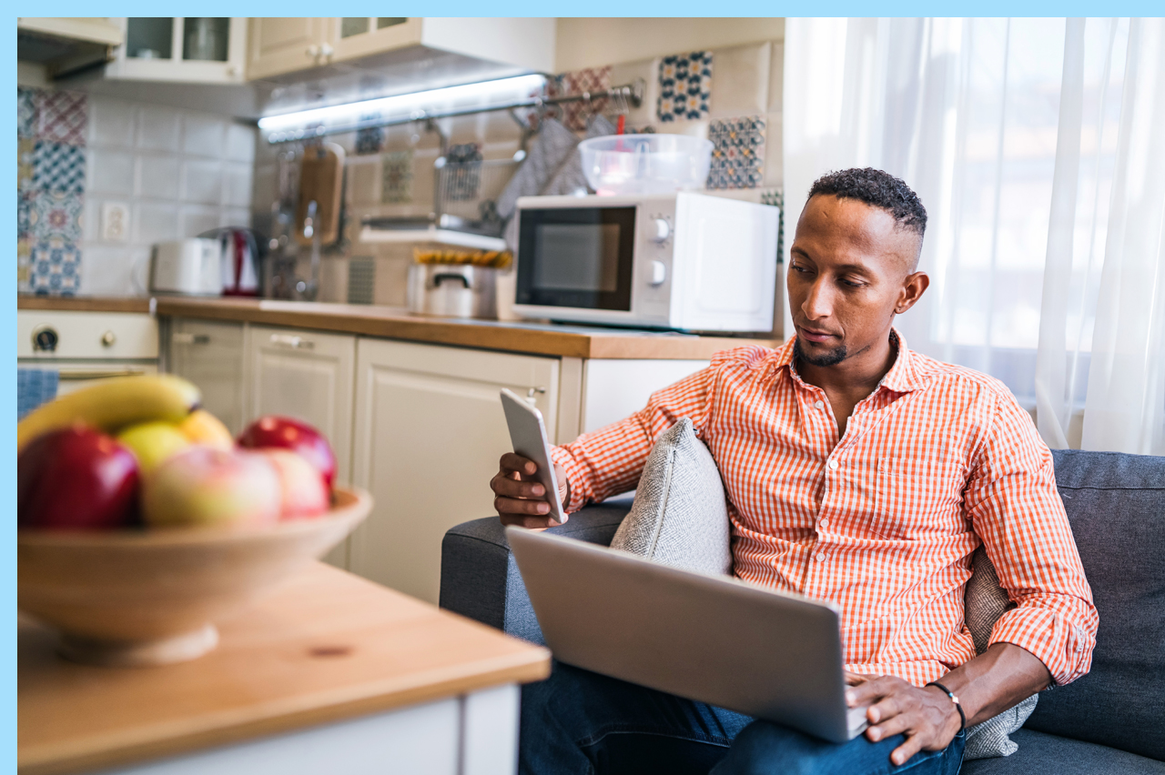 man at home researching online