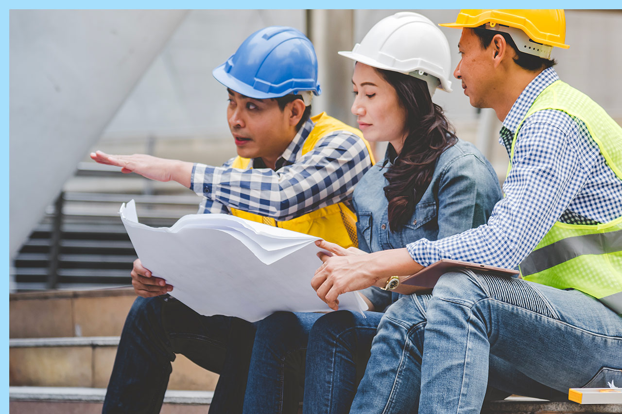 group of construction workers reviewing plans