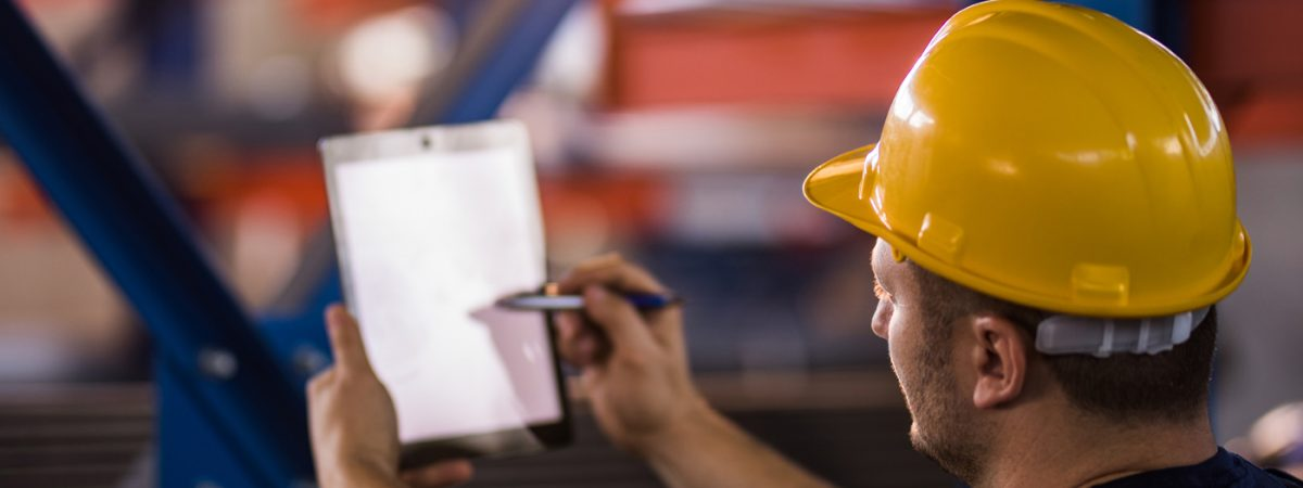 construction worker looking at paper work