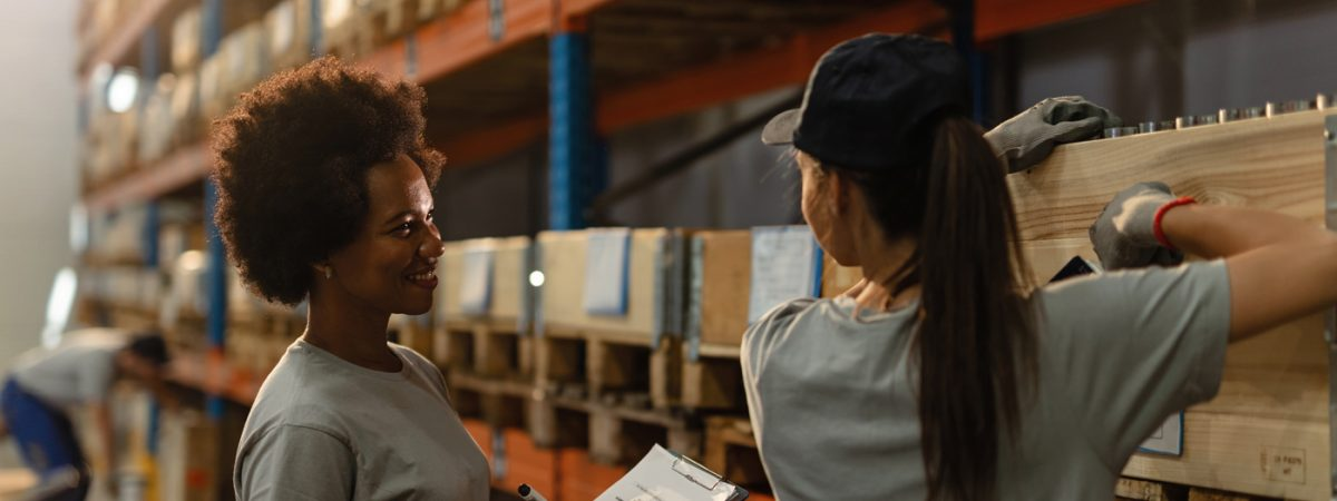 freight forwarders talking in the warehouse