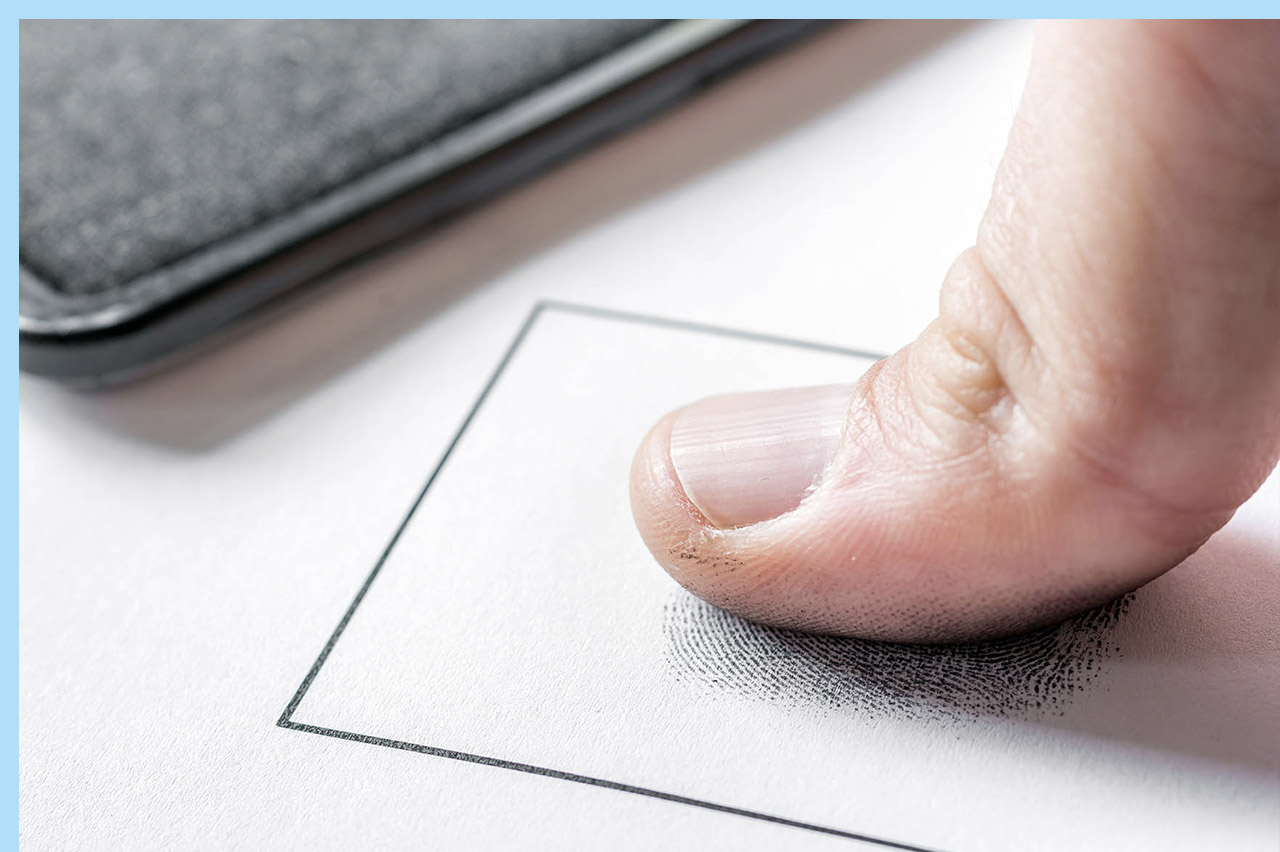 person submitting their fingerprints for the Florida public adjuster license